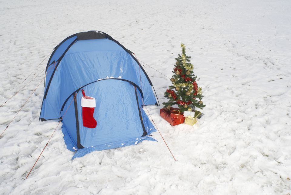 Christmas tree and tent in snow
