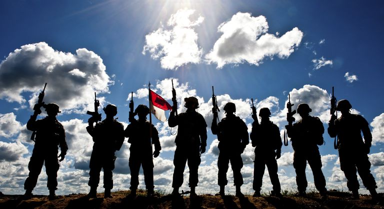 Silhouette of soldiers from the U.S. Army National Guard.