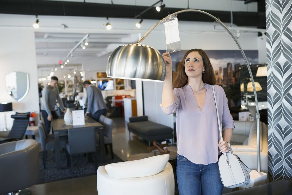woman shopping for lamp