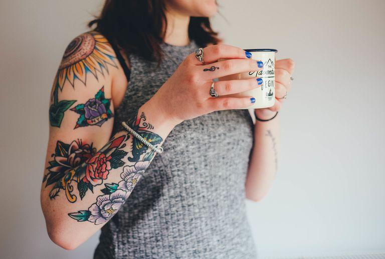 Fresh tattoos on an arm