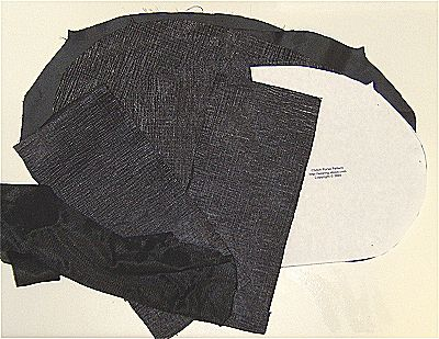 Photo of the cut out pieces for a clutch purse.