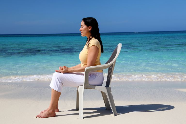 Woman sitting in a chair on the beach