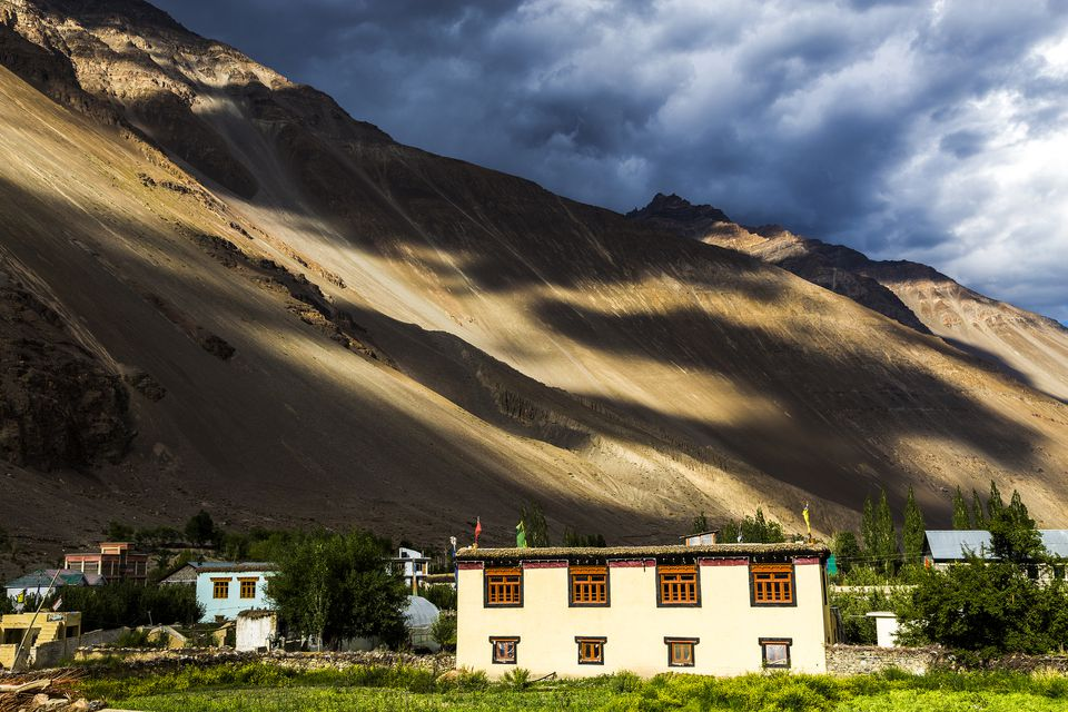 Tabo village in the Spiti valley with Himalayas and green fields