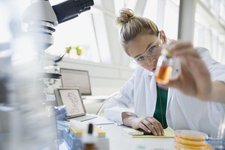 Doctor examining medical food in jar