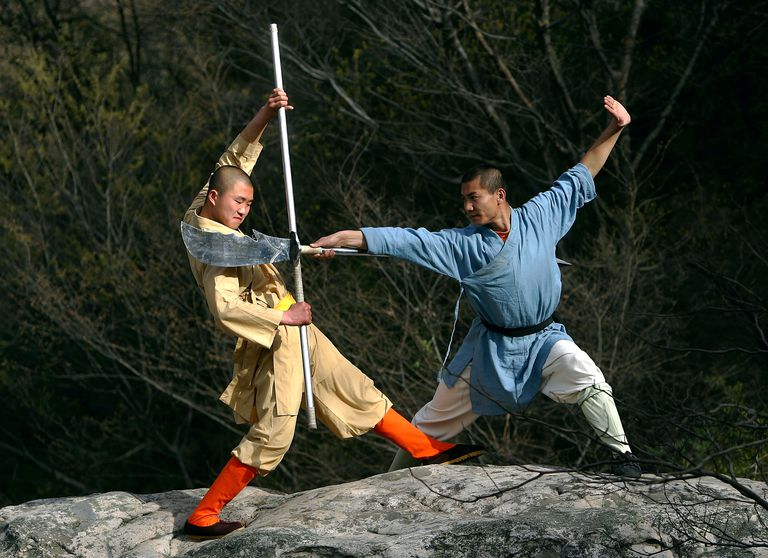 Shaolin monks train in both empty-hand kung fu and weapons fighting.