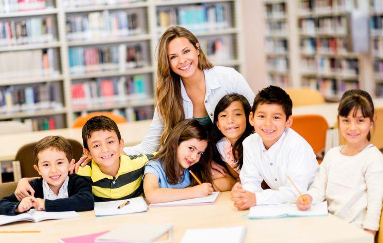 children with teacher in classroom