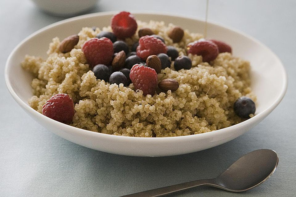 Quinoa for breakfast with berries and maple syrup