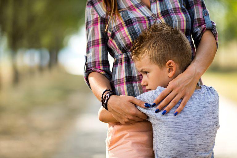 Mom hugging her son