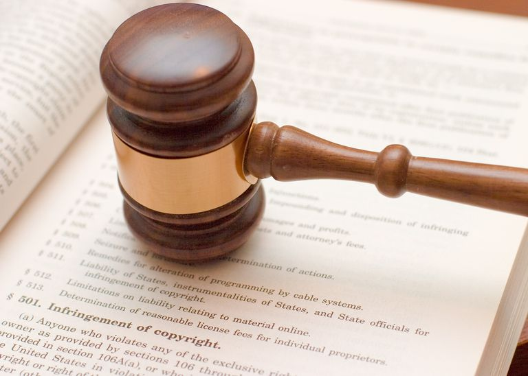 Judges gavel on book about copyright infringement