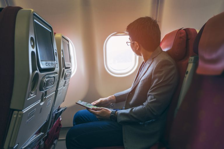 Man Traveling on a Plane