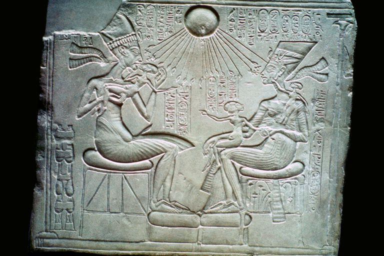 Egyptian relief of Akhenaten and Nefertiti holding their daughters, 14th century BCE