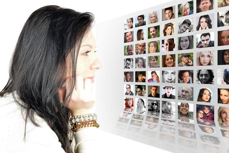 Woman examining photo album