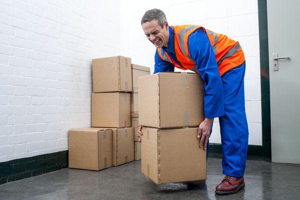 Man lifting box improperly