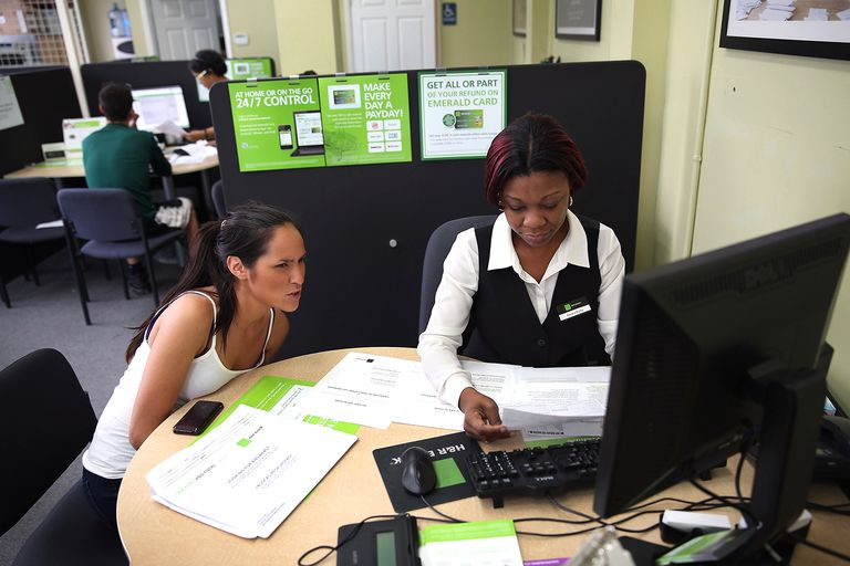Young woman prepares her taxes with a tax associate at H&R Block