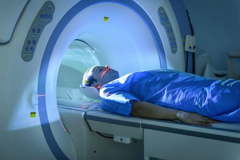 A patient enters an MRI scanner.