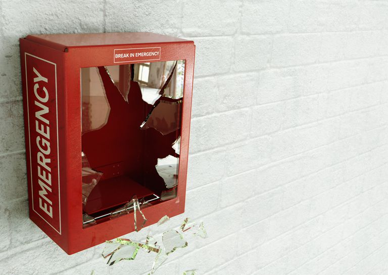Empty red emergency box with broken glass