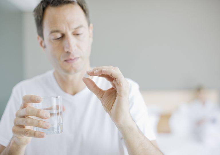 Man taking medicine