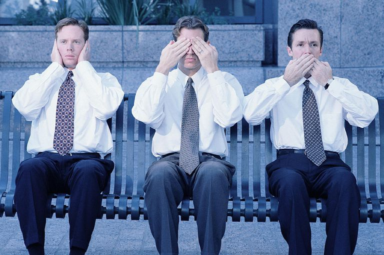 A photo of three men displaying mass media ethics by hearing, seeing and saying no evil.
