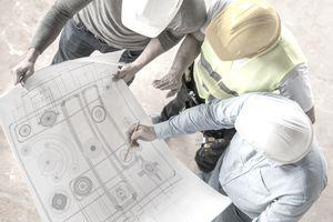 Civil engineers looking at blueprints