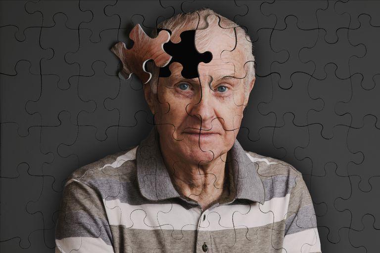 Jigsaw puzzlie, of senior man, falling apart