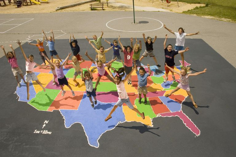 Children (6-13) jumping on map of USA, elevated view