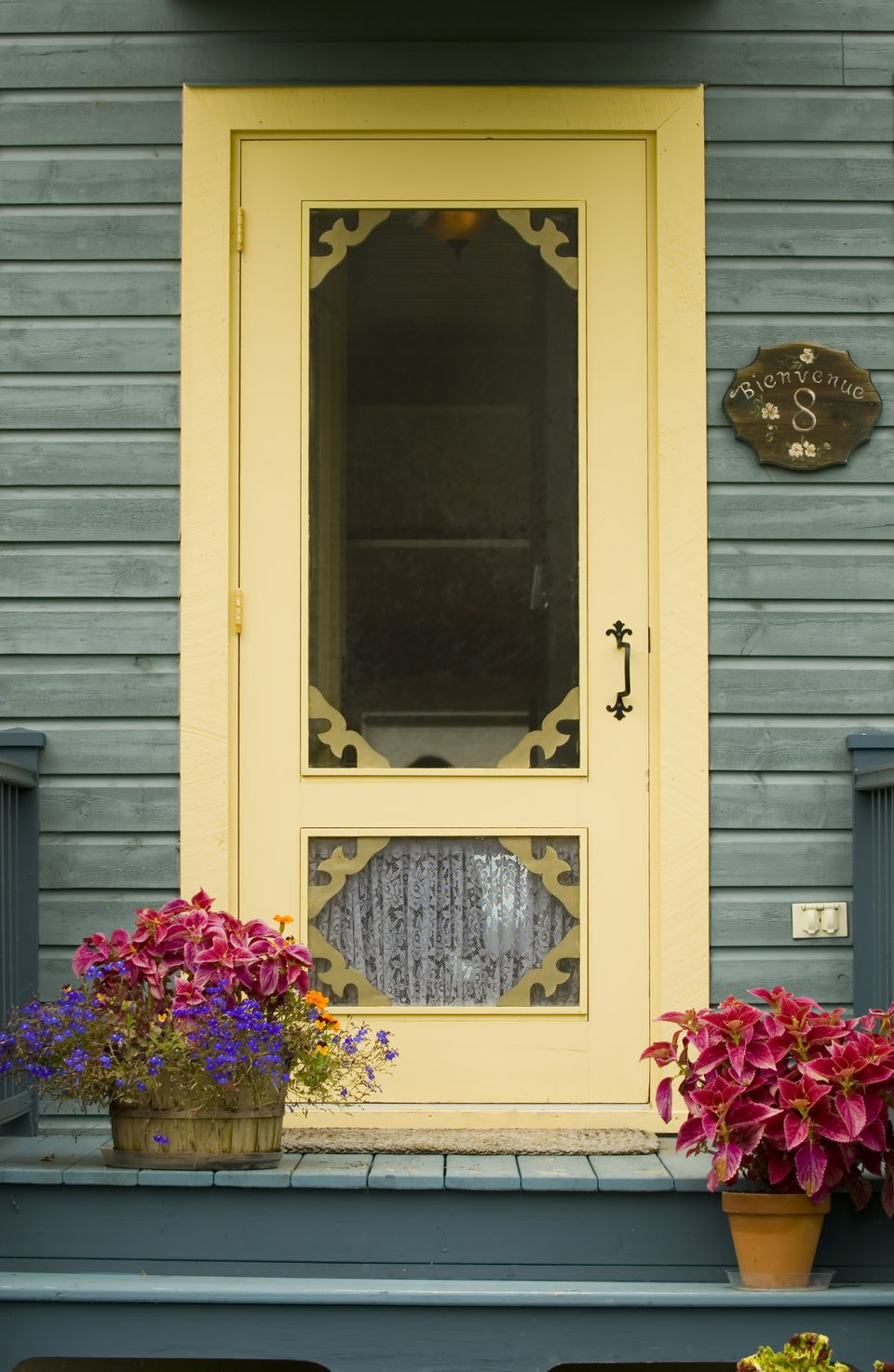 yellow door with flowers