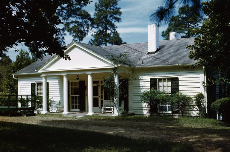 cottage plans for building. small white house with black shutters  large central portico four columns and a pediment 9 Building Plan Books for Cozy Affordable Cottages