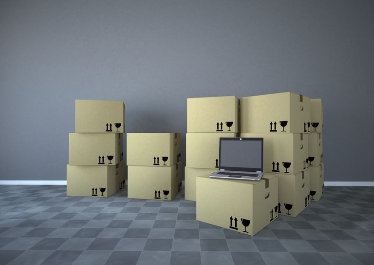 Shipping cartons with notebook in a room, 3d rendering