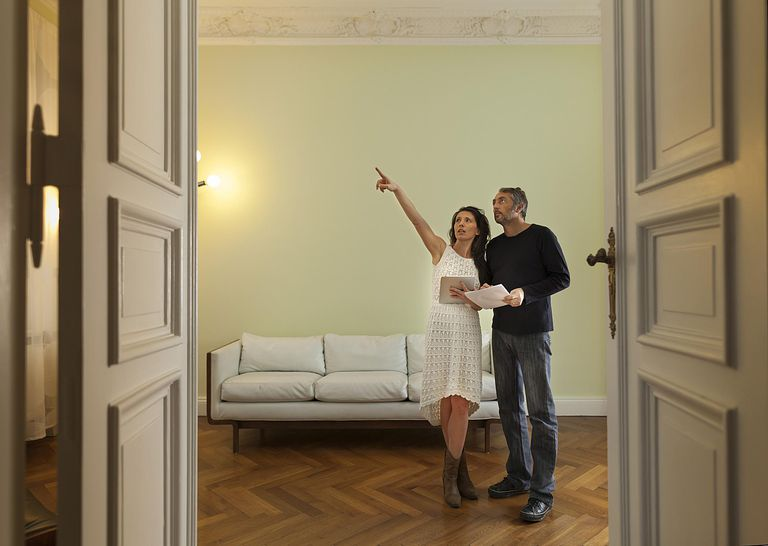 Couple Inspecting Home