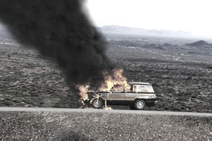 Automobile on fire in desert (Digital Composite)