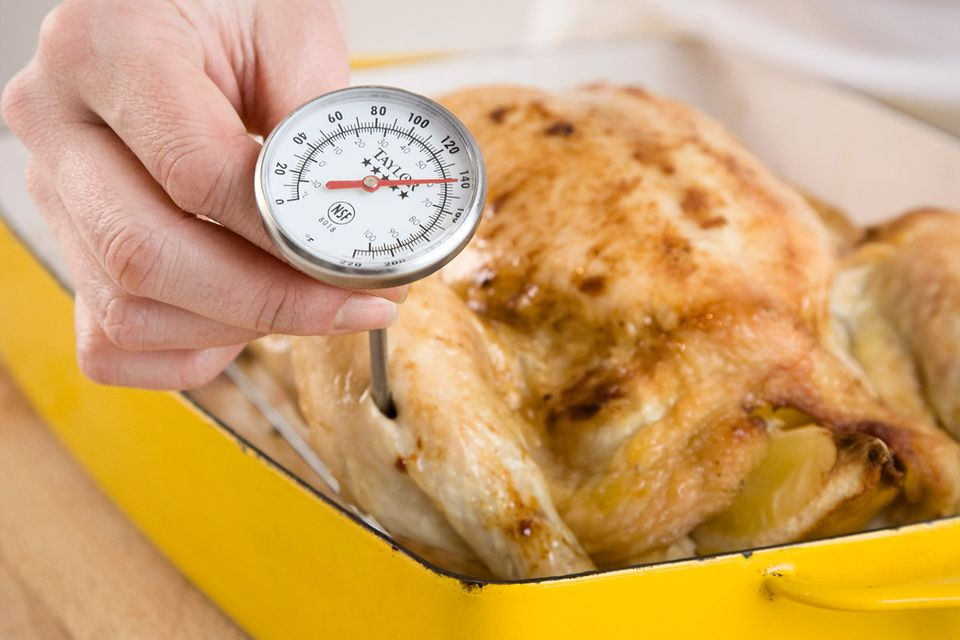 Woman Checking Temperature of Chicken