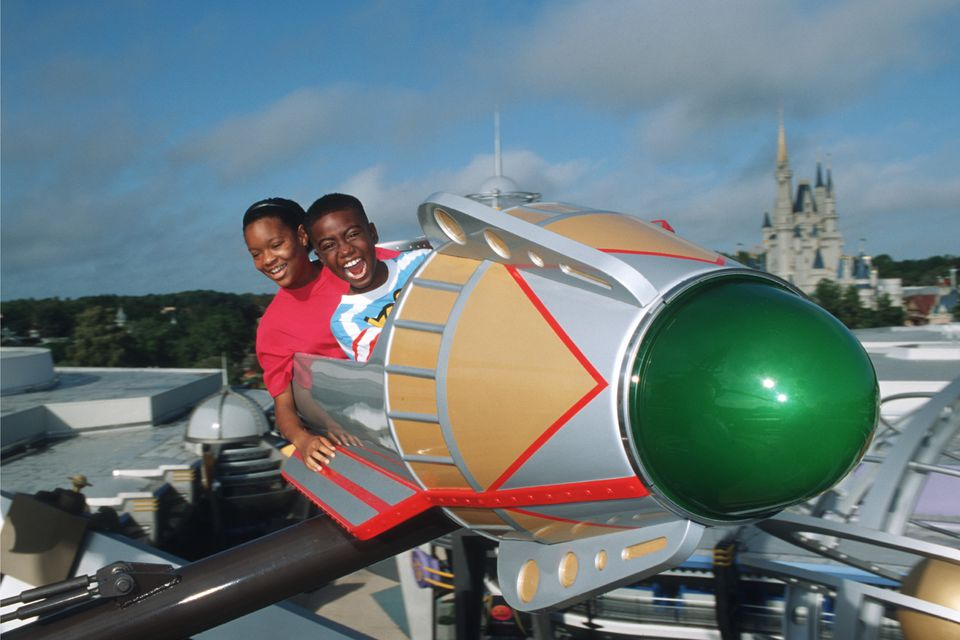 Kids take Astro Orbiter for a spin and enjoy the thrill of the ride.
