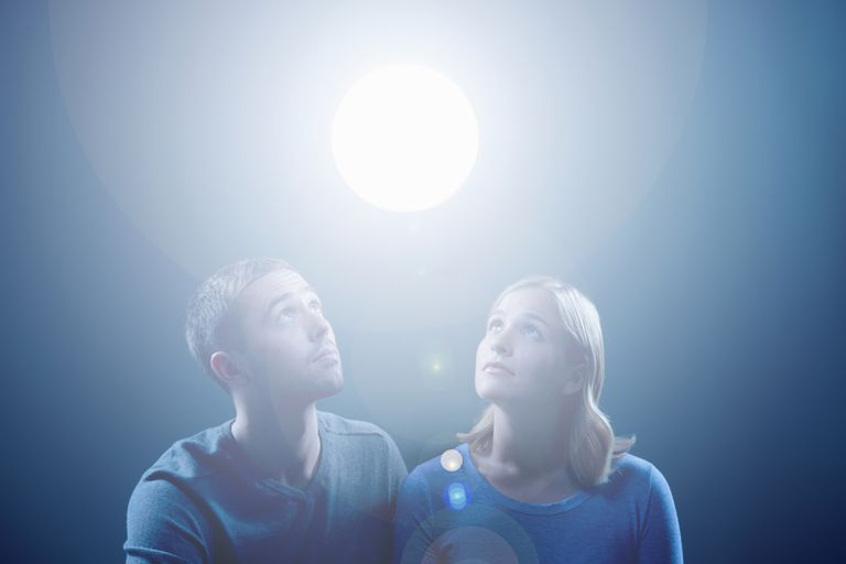 Couple looking at orb of light