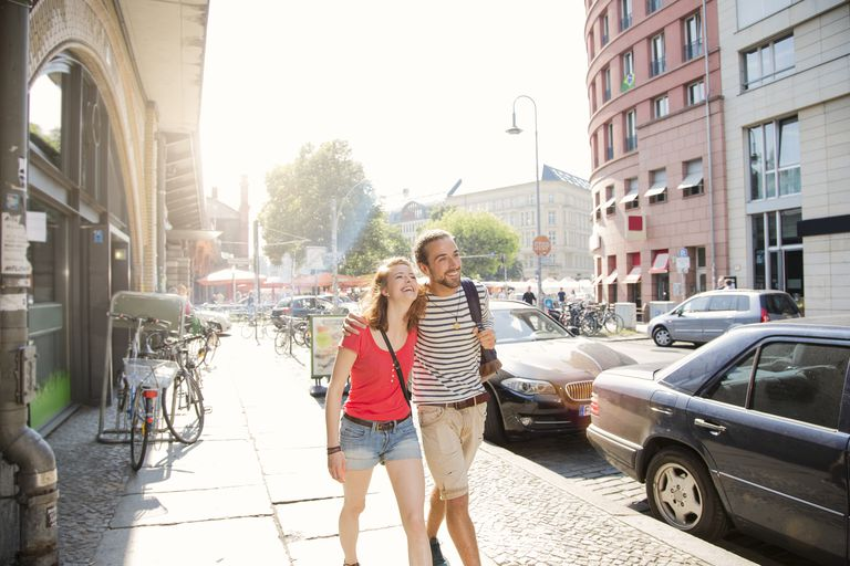 German, Berlin, Young couple walking in street