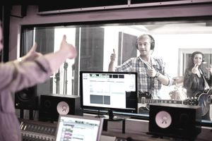 Young band recording in studio