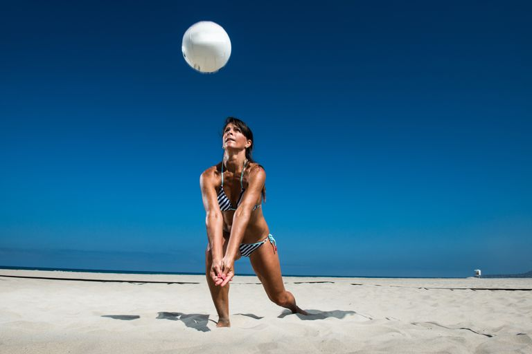 Woman bumping volleyball
