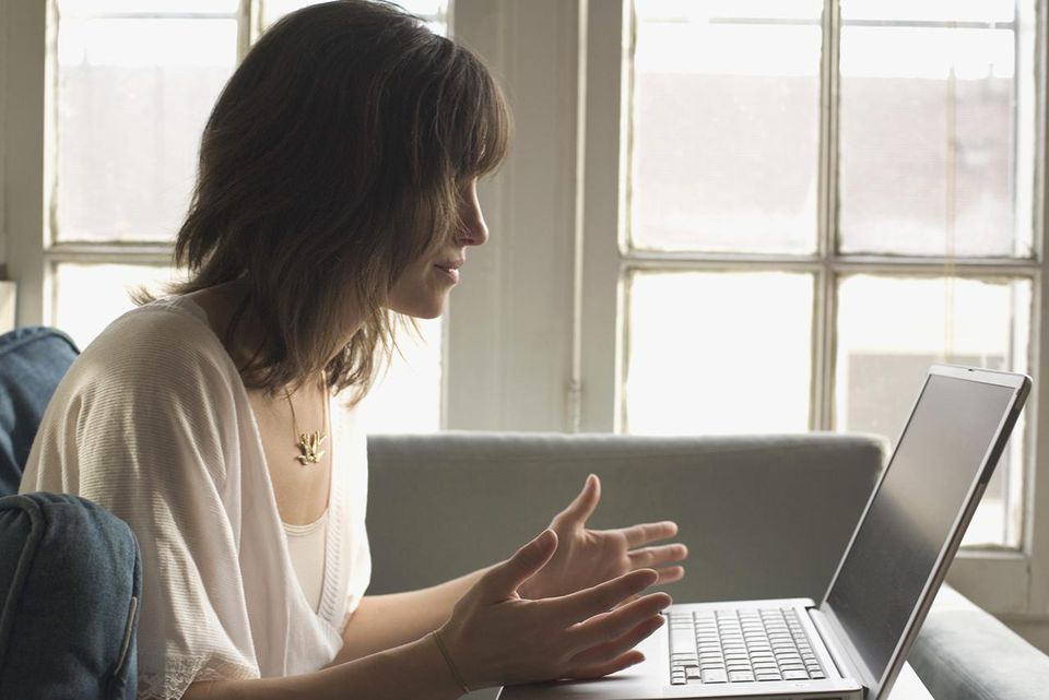 Side view of woman with laptop computer