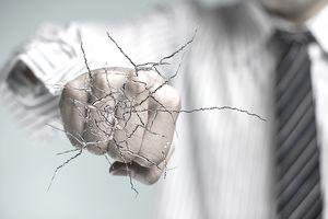 man's fist punching glass