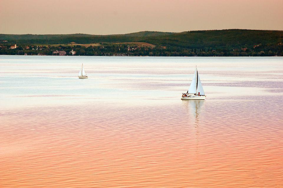 Balaton lake with boats in sunset