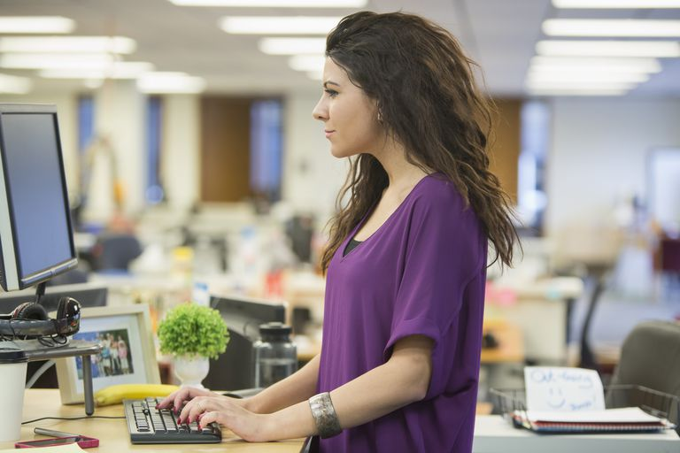 Caucasian businesswoman working at desk