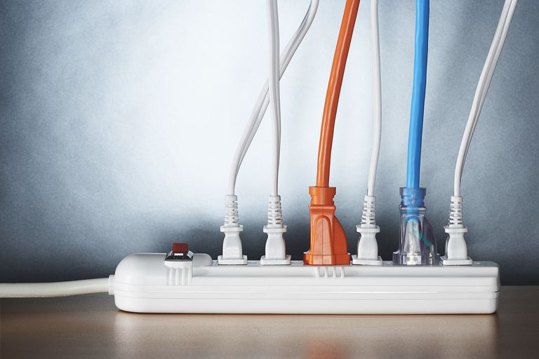 Close up of cords plugged into a power strip