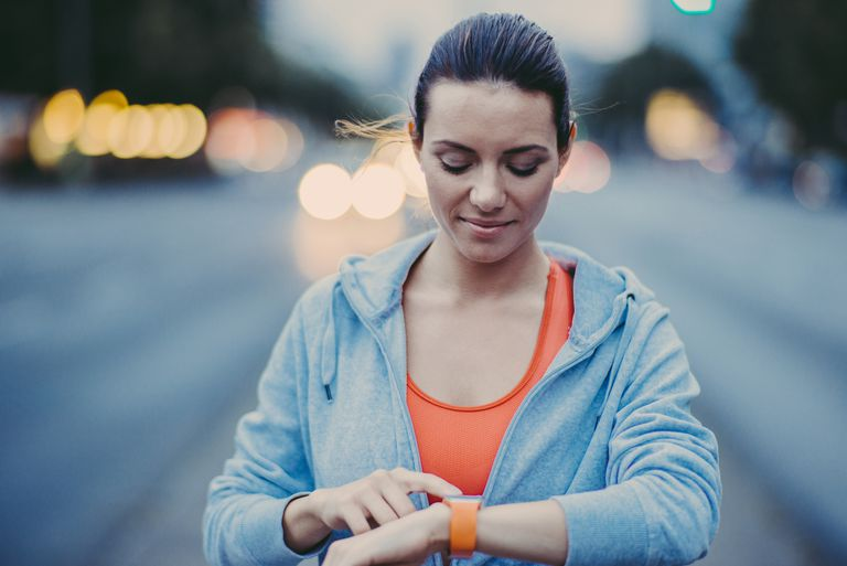 Woman checking smartwatch.