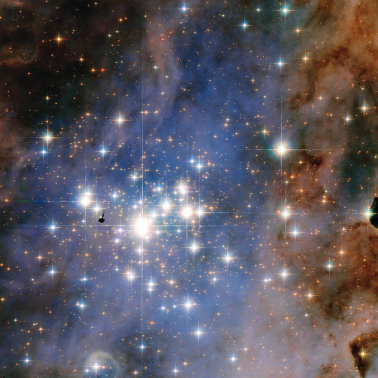 This composite image of Trumpler 14 was made with data taken in 2005-2006 with Hubble's Advanced Camera for Surveys. Blue, visible, and infrared broadband filters combine with filters that let astronomers detect hydrogen and nitrogen emission from the glowing gas surrounding the open cluster.