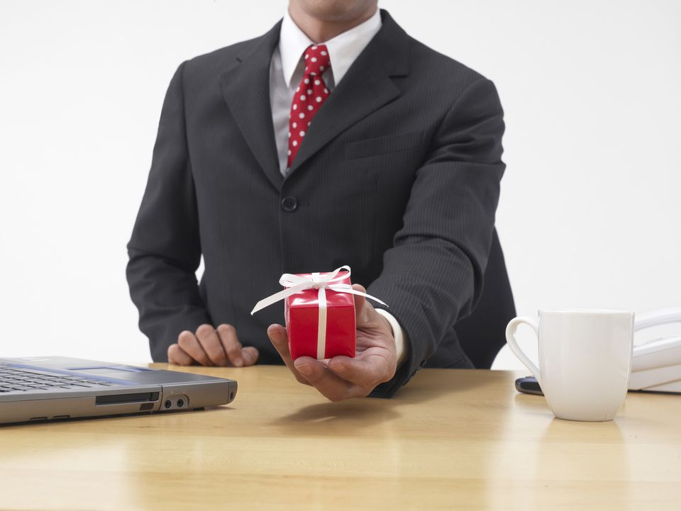 Businessman holding a wrapped gift