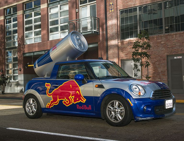 A Red Bull Mini Cooper drives outside the Convention Center and Comic-Con 2016 on July 23, 2016, in San Diego, California. San Diego, with its large, permenent military population, has become a popular summer destination for conventioneers, golf enthusiasts, and cruise lines.