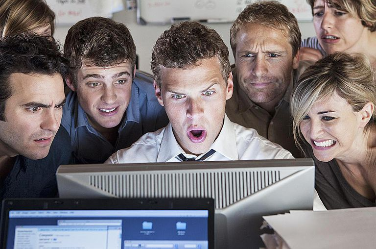 Group of people looking shocked at computer screen