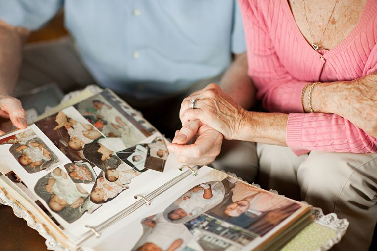 senior couple with a family photo album