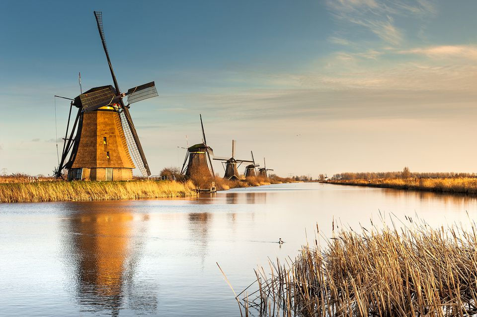 Windmills alongside a river