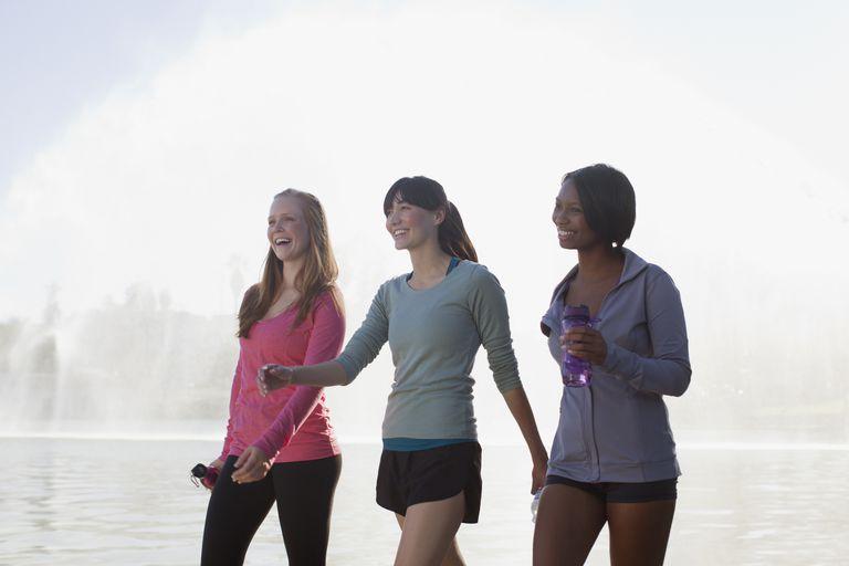 Three young women walking - Getty
