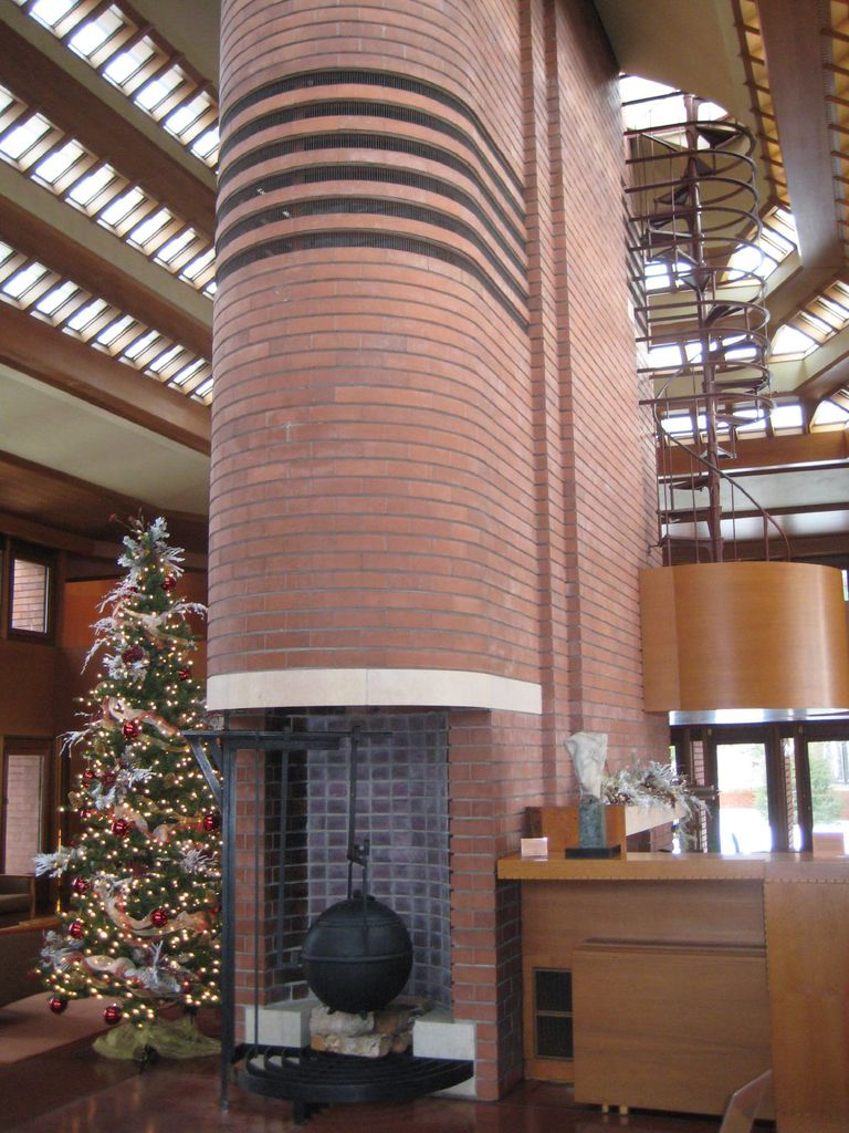 Center chimney at Wingspread dominates the open wigwam design, rising to  the ceiling skylights
